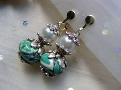 Ausgefallene und leichte Ohrringe für die Freunde der frischen Sommerfarben in silber ohne durchstochene Ohrläppchen.   Dank der Schraube ist der somm