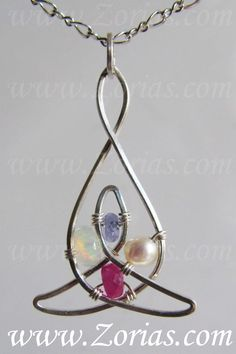 This is a new piece that can now be ordered through Zoria's, it's the Celtic mother and child knot, it is one wire that is soldered together to make a single continuous piece. Only available in Argentium Sterling Silver and starting at only $90.00!!!  This example has June, July, October and December birthstones, genuine Pearl, Ruby, Opal and Tanzanite respectively.   For custom birthstones please message me before you order!  www.Zorias.com #Wire #Wrapping