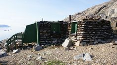 A restored traditional Greenlandic turf house on Uummannaq Island serving the children of Denmark as the 'Santa Claus Castle', where they can write letters