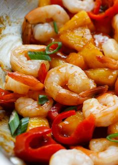 Pineapple BBQ Shrimp - a quick and easy recipe made with sautéed shrimp, spicy barbecue sauce, pineapple, and red peppers. Get the recipe at barefeetinthekitchen.com