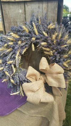 Lavender and Wheat wreath with burlap bow!!! I made this today at my Aunts lavendar festival!!!