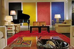 """Architect and designer Peter Marino converted a Georgian-style club on Manhattan's Upper East Side into a spirited residence for a young art-collecting couple and their children. """"There's a very important aspect to all my work, now more than ever, which is tying the interior design and architecture with the art,"""" Marino says. """"We didn't want to do an all-white space that looked like a generic downtown gallery transplanted uptown. We had to balance the contemporary art with rich finishes.""""…"""