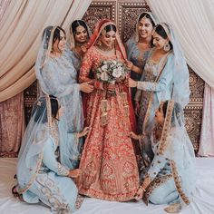 Indian bride and bridesmaids in Wellgroomed red bridal lehenga and blue bridesmaid lehengas. wedding bridesmaids Indian Bride And Bridesmaids In Wellgroomed Red Bridal Lehenga And Blue Bridesmaid Lehengas Indian Wedding Bridesmaids, Indian Bridesmaid Dresses, Desi Wedding Dresses, Indian Bridal Outfits, Bridesmaid Outfit, Blue Bridesmaids, Bridal Dresses, Indian Weddings, Hair Wedding
