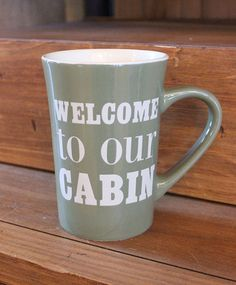 """Give your cabin guests their morning coffee in our """"Welcome to the Cabin"""" mug! This latte mug measures 5"""" tall by 5"""" wide."""