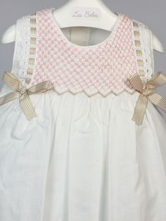 Baby dress with smocking and ribbon, using the one step trellis + cable stitch.