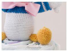 Compuesta por 40 pañales y un amigurumi hecho a mano con hilo de algodón. Según la tradición japonesa dan suerte y protegen al bebé.