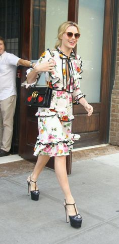 Spotted in New York City, star of Suicide Squad Margot Robbie in a Gucci Pre-Fall 2016 print dress, GG Marmont bag and double platforms with feline head hardware.