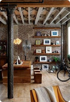 architecture and furniture. love that brick wall  with the exposed ceiling