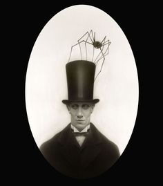 """Travis Louie: """"Herman found his prized huntsman spider in the basement of his parents' house. Although it was common to have large insects as pets in this town, it was frowned upon to have an arachnid as a pet.  When they would go for a stroll or take in a show at the theatre, Morris would hide in Herman's stovepipe hat and watch through tiny holes near the top of the hat band. Herman could even hear him clapping at the close of the each performance. It made him laugh out loud every time."""""""