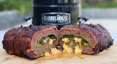 A delicious combination of meatloaf stuffed with peppers and cheese, then wrapped in a bacon weave and cooked to perfection in the Barrel House Cooker. Bacon Meatloaf, Bacon Wrapped Meatloaf, Meatloaf Recipes, Smoked Eggs, Smoked Bacon, Smoker Recipes, Outdoor Cooking, Main Meals, Healthy Eating