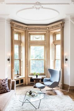 """To start out, Laurel & Wolf interior designerKimberly Winthrop recommends defining the base color of your space and styling furniture to match. """"When mixing two seemingly opposite design..."""