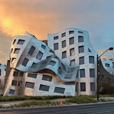 """Cleveland Clinic Lou Ruvo Center for Brain Health: Address: 888 W Bonneville Ave, Las Vegas, NV 89106 Opened: February 2007 Architectural Style: Deconstruction Architect: Frank Gehry Built in 2012, the building was designed by Frank Gehry, and looks like a stainless steel explosion. Las Vegas Mayor, Oscar Goodman, called the creation """"a cathedral in the middle of the desert"""". However, some state that it looks like the desert simply melted the metal structure."""