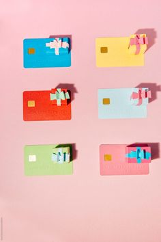 6 small gift boxes with six credit cards in two columns by Beatrix Boros - Stocksy United