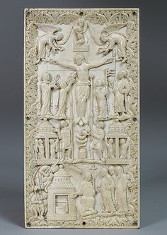 An ivory Carolingian plaque from northern France, c.870, carved with a scene of the Crucifixion and the holy women at the tomb; symbolic personifications include the sun, moon, the Church and the Synagogue, and a symbolic snake. (Metropolitan Museum of Art)