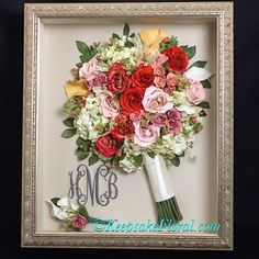 Stunning bridal bouquet and handsome boutonnière preserved and displayed in a custom shadowbox. #floralpreservation #wedding #keepsakefloral