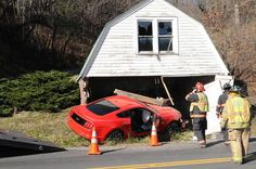 2016 Mustang GT Wreck: Virginia man test-driving a new Ford Mustang crashed into a garage, landing the vehicle on top of a vintage 1948 coupe awaiting restoration.