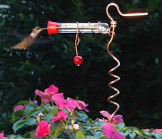 This little hummingbird feeder stakes into a flower pot, so you can attract them both with plants and sugar water. Available at Duncraft