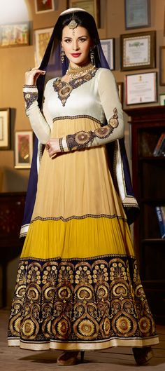 418424: Beige and Brown color family semi-stiched Bollywood Salwar Kameez.