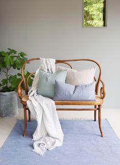 HIMLA - Hannelin throw, Sunshine cushions and Särö rug for a modern look.