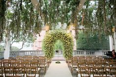 For the ceremony, Stanlee Gatti designed the pergola, which was draped in spanish moss and jasmine.