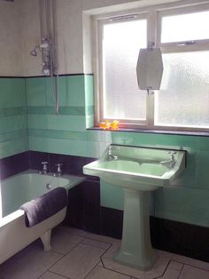 Classic Age Décor for your bathroom: Green And Black Bathroom Design With Two Tap Stuffs And Unvisible Window