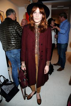 She even took on the boys in the style stakes at David Bailey's London photo exhibition, wearing this androgynous button-up shirt and frock coat with loafers and a fedora.