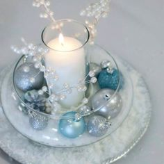 60 Adorable Winter Wonderland Wedding Ideas Winter Wonderland is a song, popularly treated as a Christmastime pop standard, and this is one of the best ideas for your winter wedding theme. Winter Centerpieces, Winter Wonderland Centerpieces, Centerpiece Ideas, Candle Centerpieces, Silver Centerpiece, Christmas Centerpieces For Table, Snowflake Centerpieces, Snowflake Decorations, Silver Christmas Decorations