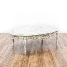 White Shabby Chic French Provincial Coffee Table - This french provincial coffee table is featured in a solid wood with a distressed white chalk paint finish. This shabby chic coffee table has curved legs, an oval table top and intricate carved floral accents. Perfect for brightening up a space! Loveseat is the best way to buy vintage home furniture in San Diego & Los Angeles.  Shabby Chic, Vintage, Mid Century Modern and much more.