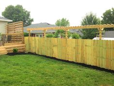 add an arbor to the top of the wooden fence