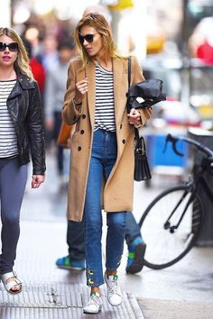 Model Anja Rubik steps out in a camel coat, striped tee, cropped jeans and Adidas x Stan Smith sneakers