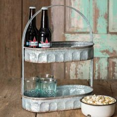 Two Tiered Corrugated Oval Tray  is perfect for so many rooms in your home. Use it for serving snacks and drinks. It would also make a wonderful caddy for your guest bath to hold extra washcloths, soaps, and toiletries. Put one in your kitchen to hold your favorite coffee cups. We know you'll love the rustic appeal of this tray!