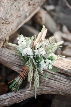 drift wood - wedding bouquet - feathers - fern - cat tails- leather wrapped bouquet handle ~ Styled by Wright Event Services Photography: Andrea Pesce Photography - www.andreapesceph... Read More: www.stylemepretty...