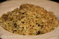 Cajun Rice Pilaf - Rice and a Trinity of veggies are first sauteed in butter, then simmered in chicken stock for a wonderful rice side dish that is just as good for pork, as it is for chicken, shrimp, fish, or beef.