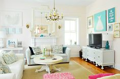Mirror, chandelier, pops of color.  House Crashing: A Happy Casual Farm House | Young House Love