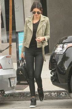 Kendall Jenner wearing Givenchy Lucrezia Bag, Res Denim Gettin Hi the Shining Pants, Versace Medusa Hi-Top Sneakers and IRO Jova Distressed Leather Jacket in Olive
