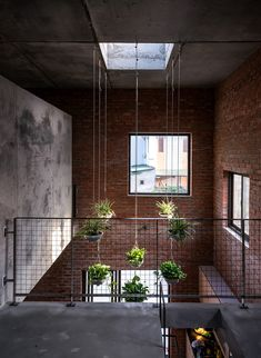Image 18 of 38 from gallery of AgriNesture / H&P Architects. Photograph by Nguyen TienThanh Water Collection System, Style Tropical, Indoor Trees, Agricultural Land, Construction Process, Construction Materials, Large Windows, Skylight, Brick Wall
