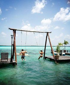 In Mexico's Bacalar Lagoon, there's a swingset for grown ups. OMG I WANT THIS!!!!!