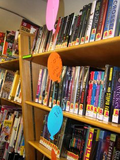 What a neat idea! Have a balloon launch on National Bookmobile Day. Make a bunch of colorful construction balloons use fish line to string the balloons together for a mobile. Have your patrons write a message on why they love their bookmobile. Hang in then all over the bookmobile.