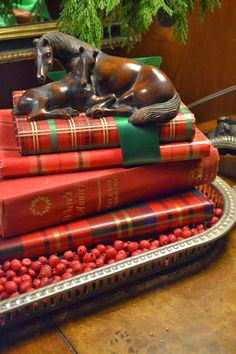 Cover books with plaid wrapping paper and stack them for visual detail - LOVE this idea!!!