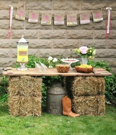 Serve food on hay bales & wooden boards for outdoor cocktail party or child's birthday