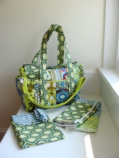 I'm in LOVE with this bag!  Patchwork Diaper Bag with Messenger Strap by WatermelonWishes