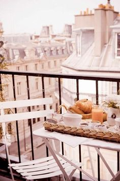 Breakfast for two on a balcony in Paris. Romantic.