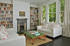 House in London; like the fireplace detail, white palate with color pop like the coffee table