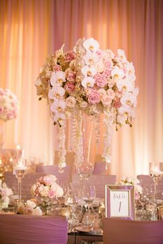 You'd never know this centerpiece was admired on a weekday would you? You'd be surprised and the great prices you get when you have your wedding on a weekday! Contact us for more information! Orchid Centerpieces, Wedding Centerpieces, High Clouds, Perfect Couple, Luxury Wedding, Memorial Day, Orchids, Wedding Planner, Table Decorations