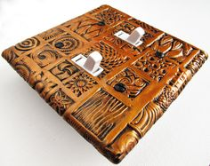 copper home decor, mosaic switch plate cover,  rustic wall decor, copper and black light switch cover CP-016-D1. $25.00, via Etsy.