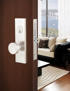 Modern front door knob vs. antique? Like the white. Would be against navy/gray door