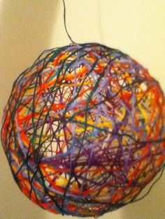 blow up a balloon...cover the balloon in strings that were dipped in glue and leave drY! WOW..great art idea for kids!