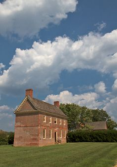 Cloud studded skies over Shirley Plantation's kitchen outbuilding. Shirley Plantation Virginia .