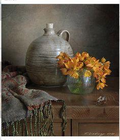 En el jarrón la flor sonríe...pero ya no ríe