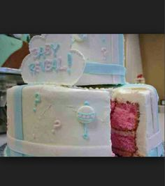 Baby Reveal! I LOVE THIS IDEA! inside the cake is either pink or blue...a surprise to the guests and/or the parents-to-be :)